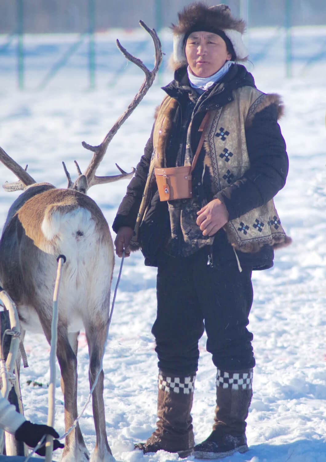 Afonia wearing an Eveny traditional competition suit during a reindeer festival