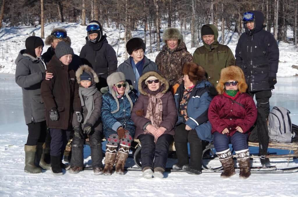 The Eveny community having an entertainment in taiga, on river ice.