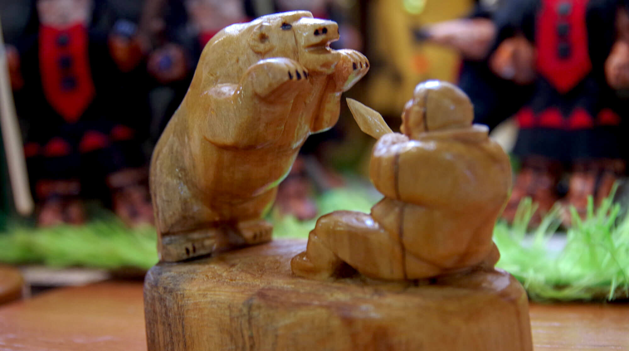 Handmade figurine representing bear hunting<