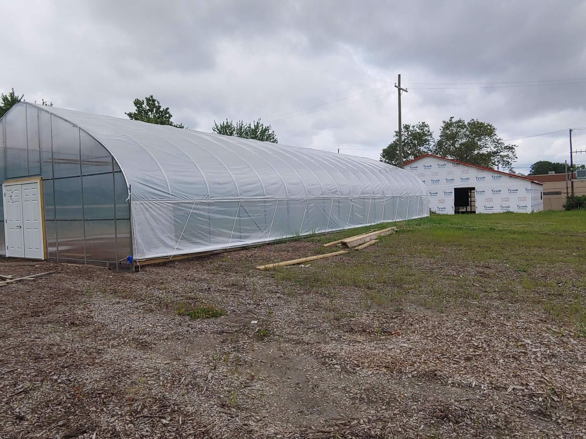 Rid-All new hoophouse installation and processing center.