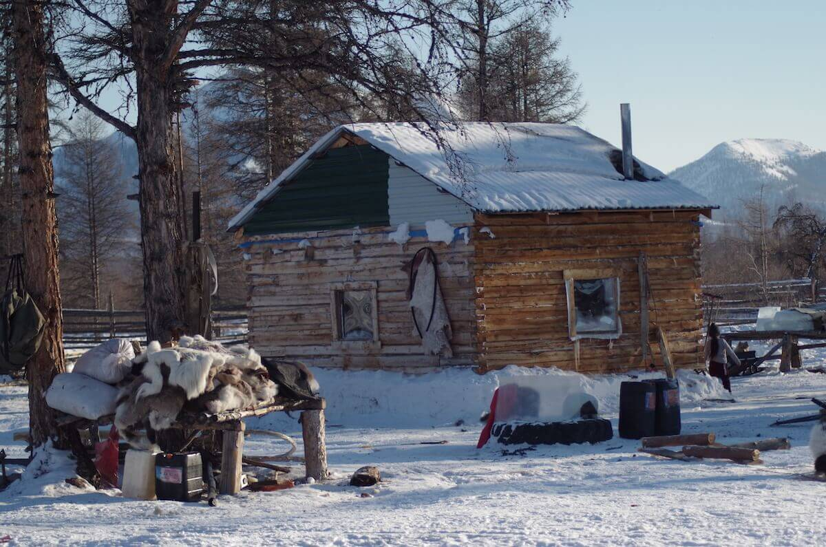 A log cabin in the Taiga where Afonia's family spends the winter months