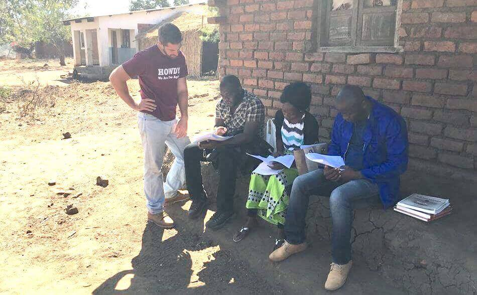 Timothy calibrating the survey instrument with enumerators in Malawi